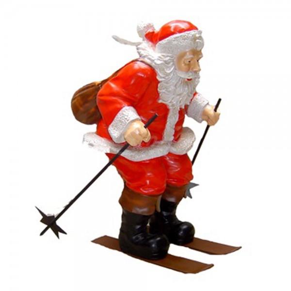 Weihnachtsmann / Nikolaus auf Skiern stehend