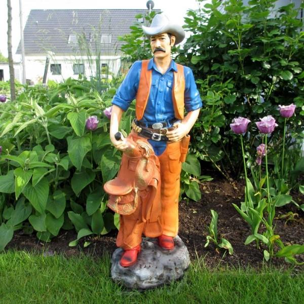 Cowboy mit Sattel und Colt (klein)