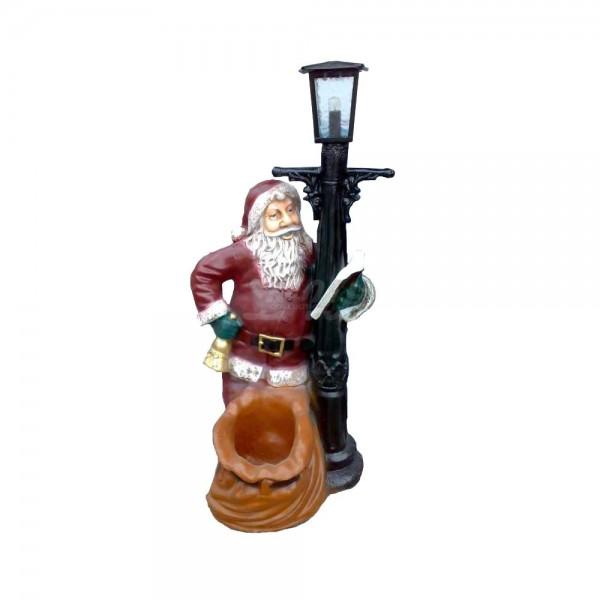 Weihnachtsmann stehend an Laterne beleuchtet (groß)
