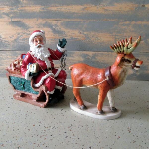Weihnachtsmann / Nikolaus mit Rentier und Schlitten (klein)